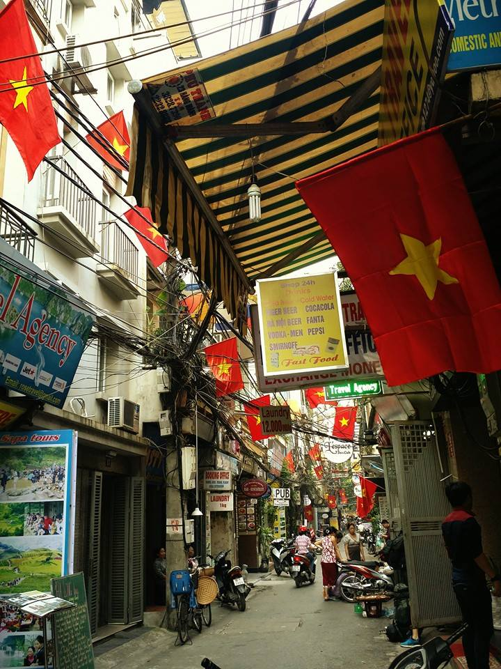 Vietnamese flags prominently hung from buildings in celebration of Hanoi's independence from the French