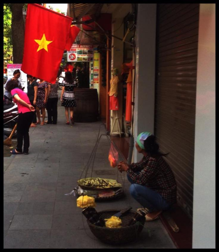 Hawker stalls and vendors line the pavements of Hanoi