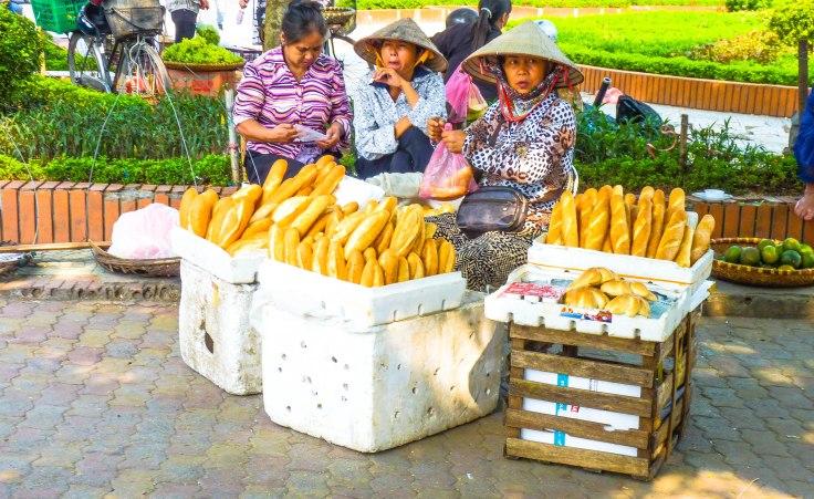 Vietnamese women selling baguette